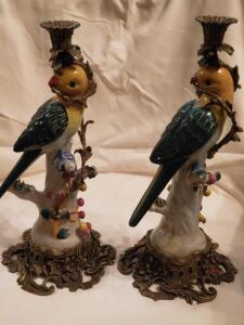 A pair of Amita porcelain and brass bird candleholders