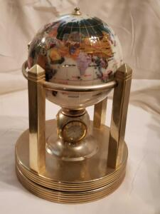 "An interesting 6"" gemstone globe with opal opalite ocean and gold galleon gold vase"