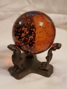 Red, controlled bubble crystal ball and stand
