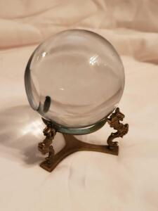 "A 4"" crystal ball with a sea horse (maybe dragon ?) stand"