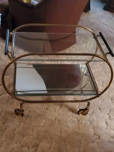 Glass topped, mirrored serving cart on wheels