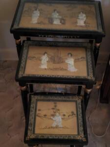 A remarkable set of 3, glass protected stacking tables, with inlaid mother of pearl scenes