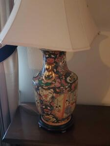 A vintage lamp with Asian scenes and beautiful designs