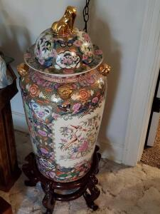 A large Chinese ginger jar or urn with a beautiful stand