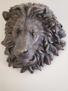 A remarkable sculpture of a lion's head, about 20 x 16""
