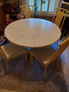 A very nice kitchen table with 4 interesting chairs