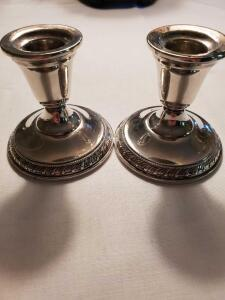 "Sterling weighted candle holders. 3"" tall, weighs 434 grams."