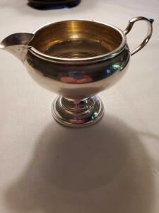 "Sterling creamer. 3.25"" tall, weighs 104 grams."