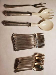 Silver plated flatware. 12 desert forks and spoons, salad set and deli fork.