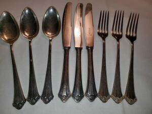 Silver plated flatware. 3 each: knife, fork, serving spoon.