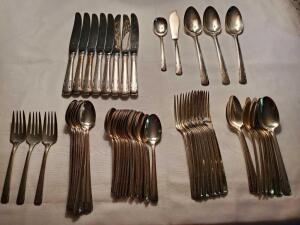 Silver plated flatware by Wallace. Contains 8 each: knives, forks, soup spoons, dessert spoons, coffee spoons, and long handled iced tea spoons. Also
