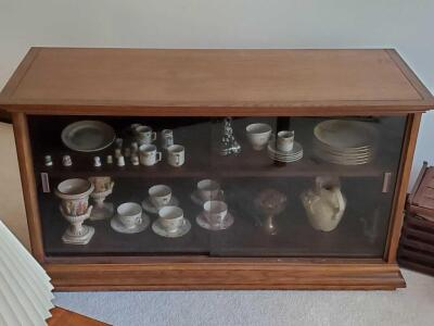 "A glass doored one-shelf cabinet, 28"" tall, 52"" across, 21"" wide (contents not included)"