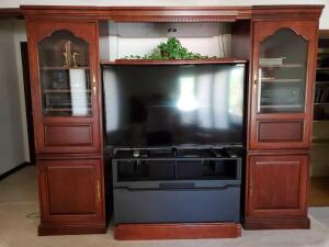 An extravagant Hooker furniture entertainment wall, great for large TVs