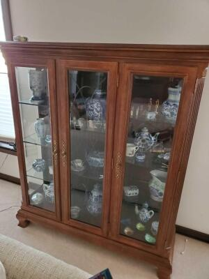 A cabinet with 3 etched glass doors