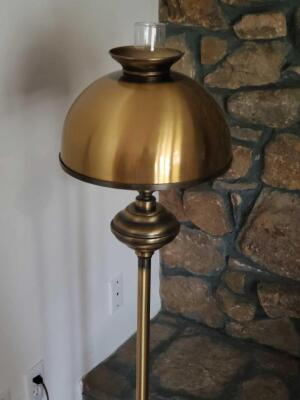 "An antique style, brass colored floor lamp, 52"" tall"