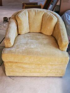An upscale swivel barrel chair made by heritage distinctive furniture
