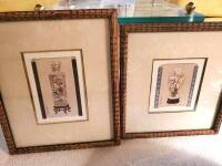 A pair of framed matted prints of Asian pottery