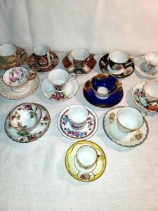 Demitasse cups and saucers. 13 sets.