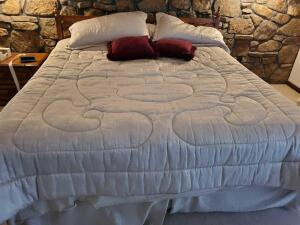 A king size bed with a beautiful wood headboard, and gorgeous Burlington comforter set