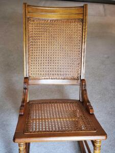 A vintage wicker rocking chair