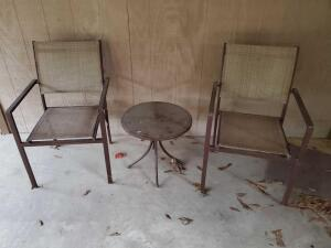 2 patio chairs and a table