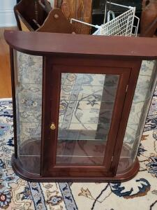 A small curio cabinet with 2 glass shelves