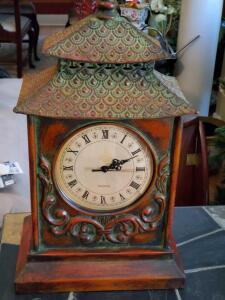 An antique styled clock with Asian influence