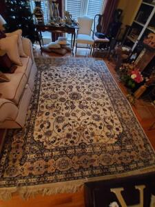 "A large area rug, 92"" wide, 120"" long"