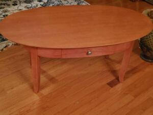 "A coffee table with a drawer, 18"" tall, 42"" across, 22"" front to back"