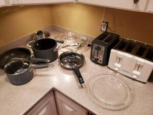 Kitchen items. Kitchen aid, calphalon pans, toasters, glass wear.