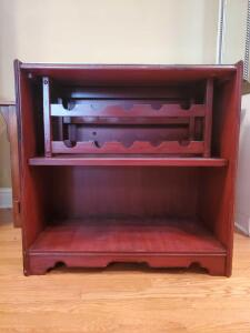 Mirror topped cabinet with wine storage rack. Dimensions are 30 x 16 x 30 in tall.