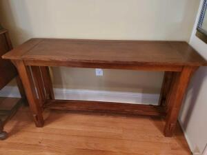 Coaster brand side table. Table is 50 x 16 x 27 in tall.