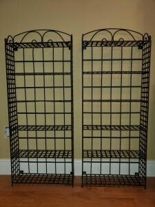 A pair of black metal shelves. Dimensions are 18.5 x 5.5 x 46.5 in tall.