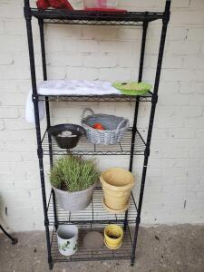 A 5 adjustable shelf baker's rack with contents
