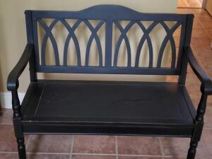 "A black bench, seat is 17"", back is 36"" tall, 40"" across, 18"" front to back"