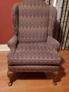 A vintage queen Anne styled wing back chair