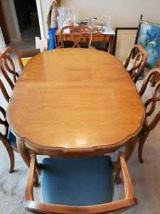 "French provincial style dining table and six chairs. Table is 64.5 x 44.5 x 29"" tall without leaf. Table has a 12""."