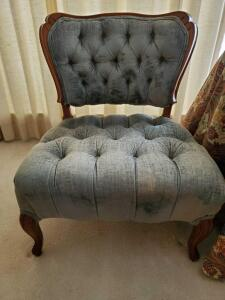 A wonderful old French provincial tufted chair in blue fabric. Chair is 26 wide x 22 deepx 31 tall x 15 seat height.