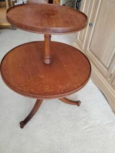 Vintage two tier, 3 leg table. Table tiers have water spots and leg has been repaired.