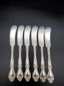 6 Gorham Melrose Sterling butter knives weighing 173 grams.