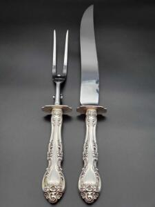 Gorham Melrose Sterling handle carving knife and fork weighing 295 grams.