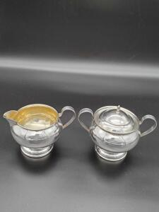 Lovely Sterling creamer and covered sugar weighing 214 grams.