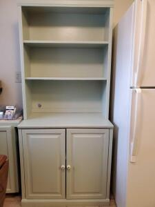 2 door wood cabinet with adjustable shelves. Cabinet is 32 wide x 18.5 deep x 72 tall.