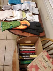 A box of dish towels and a box of cookbooks.