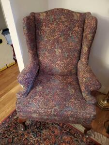 A queen Anne styled wing back chair