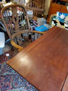 A vintage drop leaf table with 4 chairs (2 are captains)