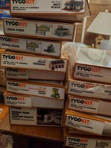A grouping of 14 tyco kit, decorations for a train, 5 unopened