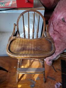 A vintage high chair, 2 doll beds (needs work), and a doll high chair