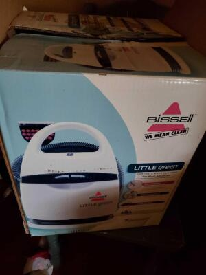 "A Bissell ""little green"" portable deep cleaner, still in the box"