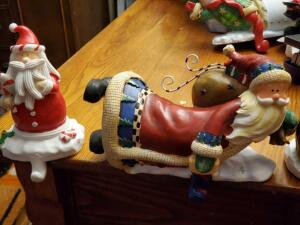 A grouping of 17 new ceramic/porcelain stocking holders; santa and snowman